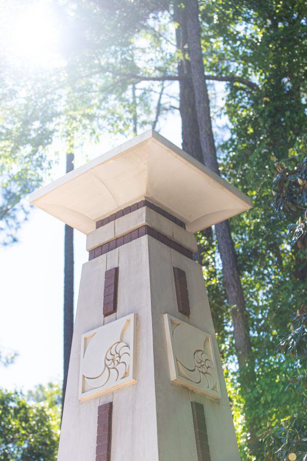 UWF decorative pillar with nautilus logo engraved on the sides