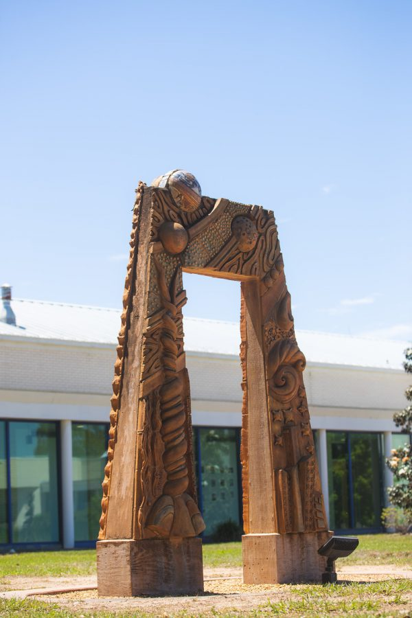 Sculpture of an Arch Outside Building 82
